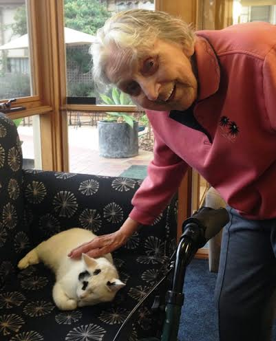 Bonnie getting a pat from one of the residents